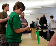 Sean Nash, 11, checks out a 3D printed robot arm at the B. Thomas Golisano College of Computing and Information Sciences during Imagine RIT in Rochester on Saturday, May 2, 2015.