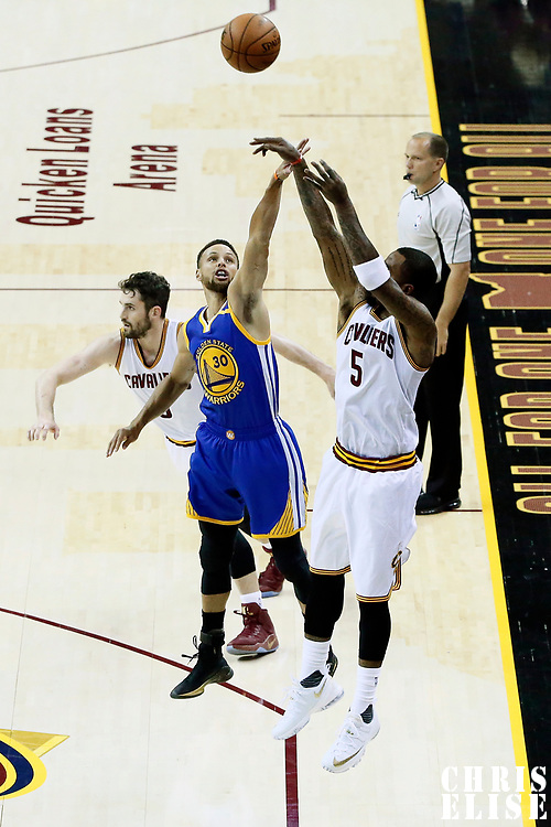 09 June 2017: Cleveland Cavaliers guard JR Smith (5) takes a jump shot over Golden State Warriors guard Stephen Curry (30) during the Cleveland Cavaliers 137-11 victory over the Golden State Warriors, in game 4 of the 2017 NBA Finals, at  the Quicken Loans Arena, Cleveland, Ohio, USA.