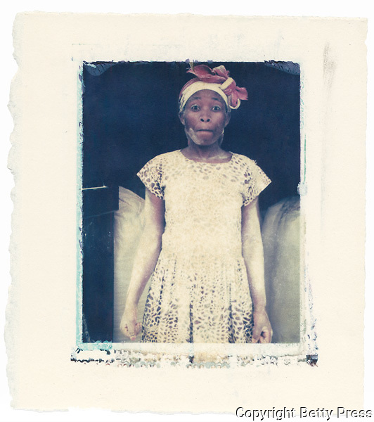 Woman working in a flour mill, Uganda<br />
