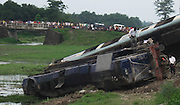 A view of a incident side, where the coaches of railway were lying on the ground, when anti-talks faction of the National Democratic Front of Bodoland (Ranjan Daimary Group) that is, shortly say - NDFB (R), one of the insurgent group of northeast India, triggered a powerful blast, which flung the locomotive and two numbers of coach of a train (known as - Garib Rath Express) bound for Kolkata (capital of Indian State West Bengal) from Guwahati, the capital of Eastern Indian State, Assam at around 02:28 am, killing a 06-year-old boy (Durlav Sethia) and injuring 23-numbers of  other at Gossaigaon in Kokrajhar district of the Indian State Assam on 08th July, 2010, during Bodo militants, straining at the leash after the arrest of their leader. Pic-Shib Shankar Chatterjee