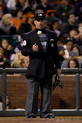 SAN FRANCISCO, CA - SEPTEMBER 09:  MLB umpire Jim Wolf #28 tosses a ball behind home plate during the fifth inning between the San Francisco Giants and the Arizona Diamondbacks at AT&T Park on September 9, 2014 in San Francisco, California.  The San Francisco Giants defeated the Arizona Diamondbacks 5-1.  (Photo by Jason O. Watson/Getty Images) *** Local Caption *** Jim Wolf