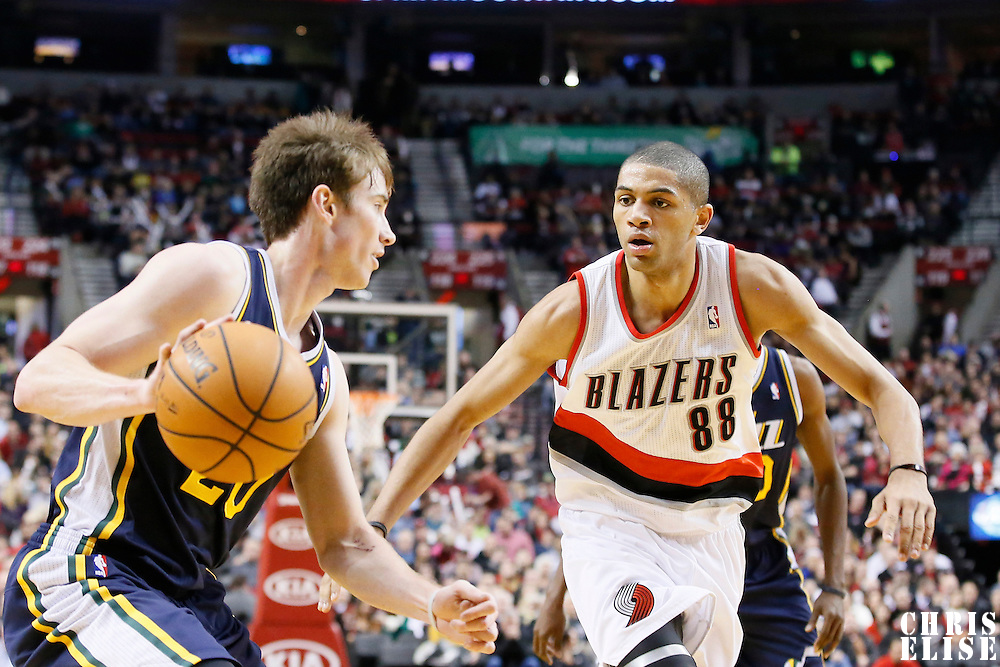 06 December 2013: Portland Trail Blazers small forward Nicolas Batum (88) defends on Utah Jazz shooting guard Gordon Hayward (20) during the Portland Trail Blazers 130-98 victory over the Utah Jazz at the Moda Center, Portland, Oregon, USA.