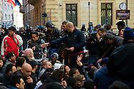 Roma 9 Marzo 2012.Manifestazione dei Movimenti per il diritto all'abitare davanti al CIPE, Comitato Interministeriale per la Programmazione Economica,che oggi doveva stanziare 20 milioni di euri per la compensazione per la TAV,i manifestanti protestavano per l'uso del denaro pubblico in opere come la TAV..Nella  foto:agenti di polizia chiedono i documenti dei manifestanti