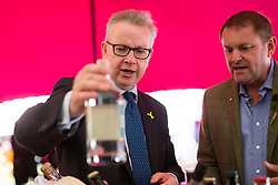 © Licensed to London News Pictures. 12/07/2017. Harrogate UK. Michael Gove Secretary of State for Environment, Food & Rural Affairs looks at bottles of Alcohol with Sir Gay Verity at the 159th Great Yorkshire Show in Harrogate today. Photo credit: Andrew McCaren/LNP