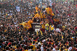 Devotees try to touch and kiss the life-size statue of the Black Nazarene during the annual feast of the Black Nazarene in Manila, the Philippines, Jan. 9, 2013. The Black Nazarene, a life-size wooden statue of Jesus Christ carved in Mexico and brought to the Philippines in the 17th century, is believed to have healing powers in this country. Authorities said about 500,000 participated in the procession that started in Manila's Rizal Park, Philippines, January 9, 2013. Photo by Imago / i-Images...UK ONLY