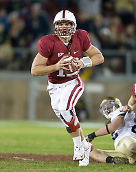November 28, 2009; Stanford, CA, USA;  Stanford Cardinal quarterback Andrew Luck (12) scrambles during the second quarter against the Notre Dame Fighting Irish at Stanford Stadium.  Stanford defeated Notre Dame 45-38.
