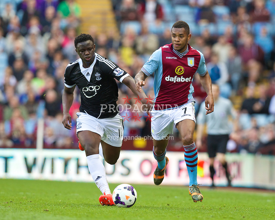 BIRMINGHAM, ENGLAND - Saturday, April 19, 2014: Aston Villa's Leandro Bacuna in action against Southampton's Victor Wanyama during the Premiership match at Villa Park. (Pic by David Rawcliffe/Propaganda)