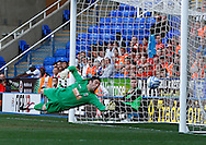 Picture by Andrew Tobin/Focus Images Ltd. 07710 761829. 24/03/12 Adam Federici of Reading saves from Kebe - ball hits the post and rebounds for Harte to score during the Npower Championship match at Madejski stadium, Reading.