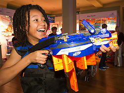 © Licensed to London News Pictures. 31/10/2012. London, UK. 11 year old Caius Duncombe shoots a Hasbro 'Nerf-N-Strike Elite Hail-Fire' (RRP GB£44.99) in London today (31/10/12) as the Toy Retailers Association releases its 13 Dream Toys for Christmas 2012. Photo credit: Matt Cetti-Roberts/LNP