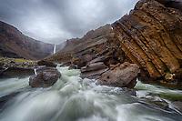 Hengifoss waterfall. Heavy rain.