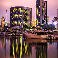 Photo of San Diego at night at Embarcadero Marina with luxury yachts and downtown San Diego buildings. Photo is high resolution and was taken in 2012.