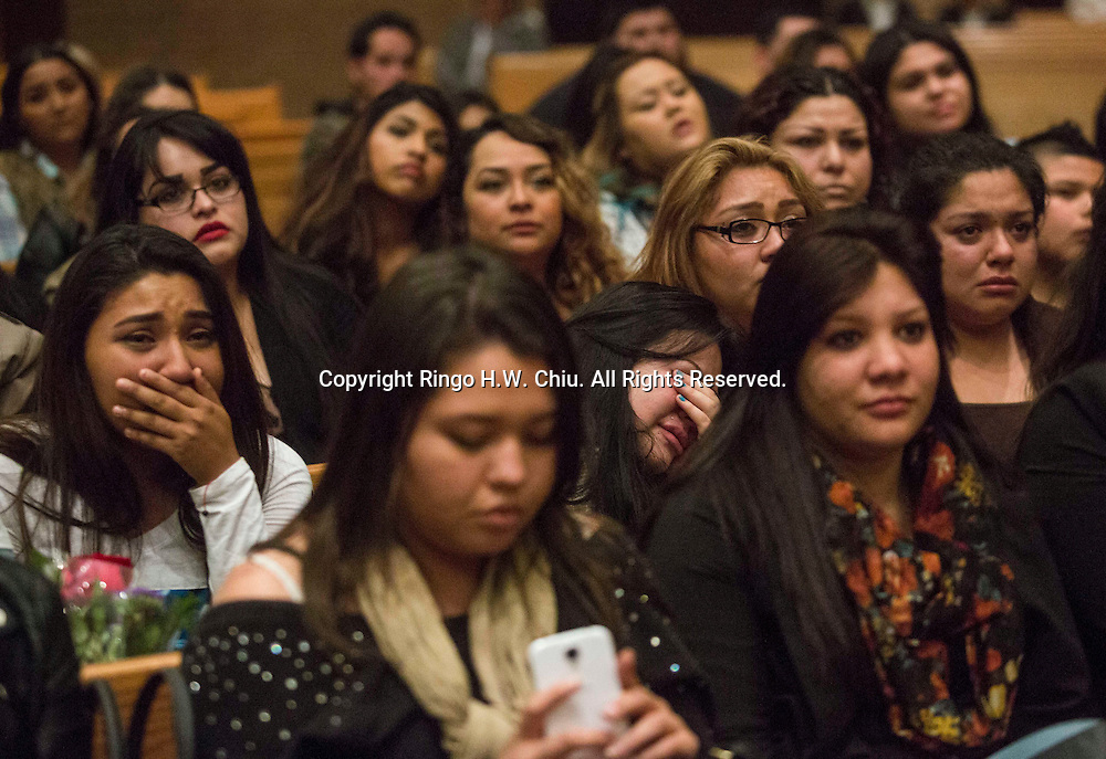 Fans cry in a memorial service for Mexican singer Ariel Camacho at St. Joseph the Worker Catholic church in the Winnetka area of Los Angeles, Calif. Tuesday March 3, 205. Camacho, a popular 'grupera' singer in Mexico, was killed in a traffic accident last month while leaving a concert. He was 22. (AP Photo/Ringo H.W. Chiu)