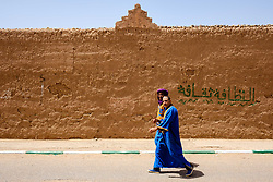 Two men in traditional dress walking in a street  in Mhamid, Morocco<br /> <br /> (c) Andrew Wilson | Edinburgh Elite media
