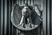 An art deco style eagle sculpture decorate the rear facade of the 100 Broadway building