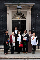 © Licensed to London News Pictures. 10/05/2012. LONDON, UK. Bianca Jagger and supporters stand on the doorstep of number 10 Downing Street as they urge UK Prime Minister David Cameron to support the Tibetan people. Photo credit: Matt Cetti-Roberts/LNP