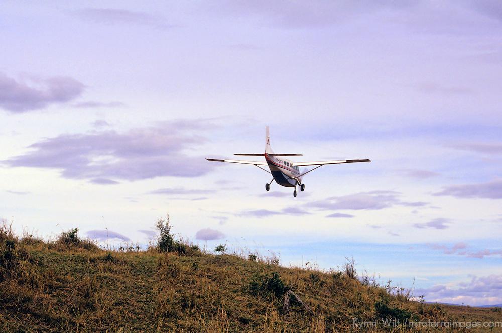 Africa, Kenya, Maasai Mara. Bush flight arrives at the airstrip of the Maasai Mara Reserve.