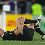 Aaron Cruden, New Zealand, injures his knee during the New Zealand V France Final at the IRB Rugby World Cup tournament, Eden Park, Auckland, New Zealand. 23rd October 2011. Photo Tim Clayton...