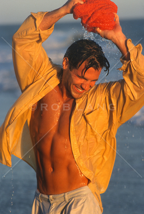 Man cooling himself off with a wet towel