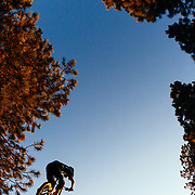 Kent Billingsley get air off a jump in the woods of Missoula, Montana.