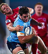 SUPER RUGBY - Dave Dennis struggles past Peter Hynes to score. Images from the round 2 match between the NSW Waratahs and the Queensland Reds. Played at ANZ Stadium, Sydney Olympic Park, Saturday, 26 February 2011. Photo: Murray Wilkinson (SMP Images)