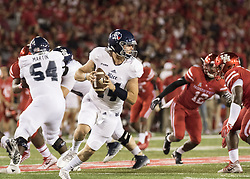 September 16, 2017 - Houston, TX, USA - Rice Owls quarterback Jackson Tyner (14) rolls out looking to pass during the second quarter of the college football game between the Houston Cougars and the Rice Owls at TDECU Stadium in Houston, Texas. (Credit Image: © Scott W. Coleman via ZUMA Wire)