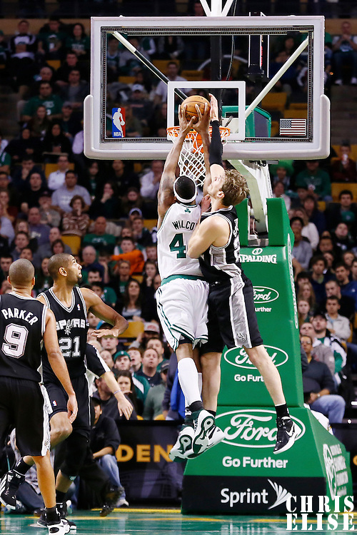 21 November 2012: Boston Celtics power forward Chris Wilcox (44) dunks the ball on San Antonio Spurs power forward Tiago Splitter (22) during the San Antonio Spurs 112-100 victory over the Boston Celtics at the TD Garden, Boston, Massachusetts, USA.