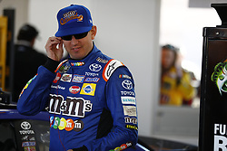 March 2, 2018 - Las Vegas, Nevada, United States of America - March 02, 2018 - Las Vegas, Nevada, USA: Kyle Busch (18) hangs out in the garage during practice for the Pennzoil 400 at Las Vegas Motor Speedway in Las Vegas, Nevada. (Credit Image: © Justin R. Noe Asp Inc/ASP via ZUMA Wire)