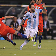 EAST RUTHERFORD, NEW JERSEY - JUNE 26: Lionel Messi #10 of Argentina is fouled by Marcelo Diaz #21 of Chile during the Argentina Vs Chile Final match of the Copa America Centenario USA 2016 Tournament at MetLife Stadium on June 26, 2016 in East Rutherford, New Jersey. (Photo by Tim Clayton/Corbis via Getty Images)