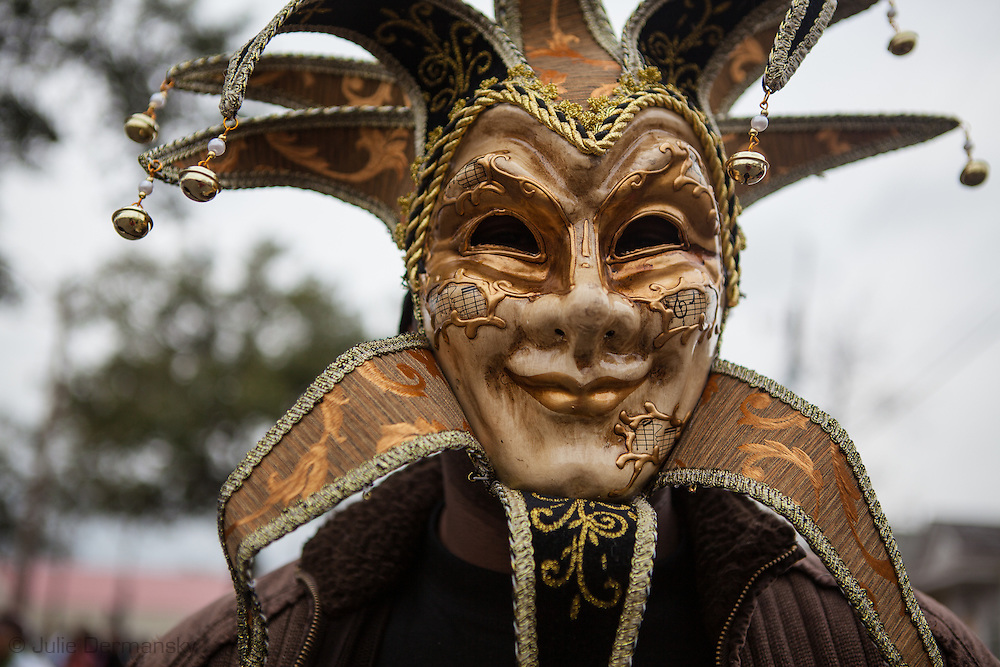 Man wearing Mardi Gras mask at the Zulu Parade on Fat tuesday. Mardi Gras 2011 in New Orleans is expected to be have the largest attendance of all time due to the dates overlapping with college spring break. Mardi Gras also known as Carnival begins on or after Epiphany and ending on the day before Ash Wednesday.