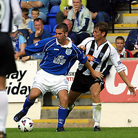 St Johnstone v Dunfermline.... 04.8.01<br />New St Johnstone striker Peter MacDonald gets pulled about by Andrius Skerla<br /><br />Pic by Graeme Hart<br />Copyright Perthshire Picture Agency<br />Tel: 01738 623350 / 07990 594431