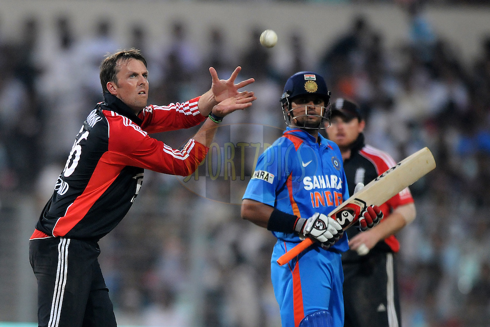 Graeme Swann of England collects a ball during the 5th One Day International ( ODI ) match between India and England held at the Eden Gardens Stadium, Kolkata on the 23rd October 2011..Photo by Pal Pillai/BCCI/SPORTZPICS