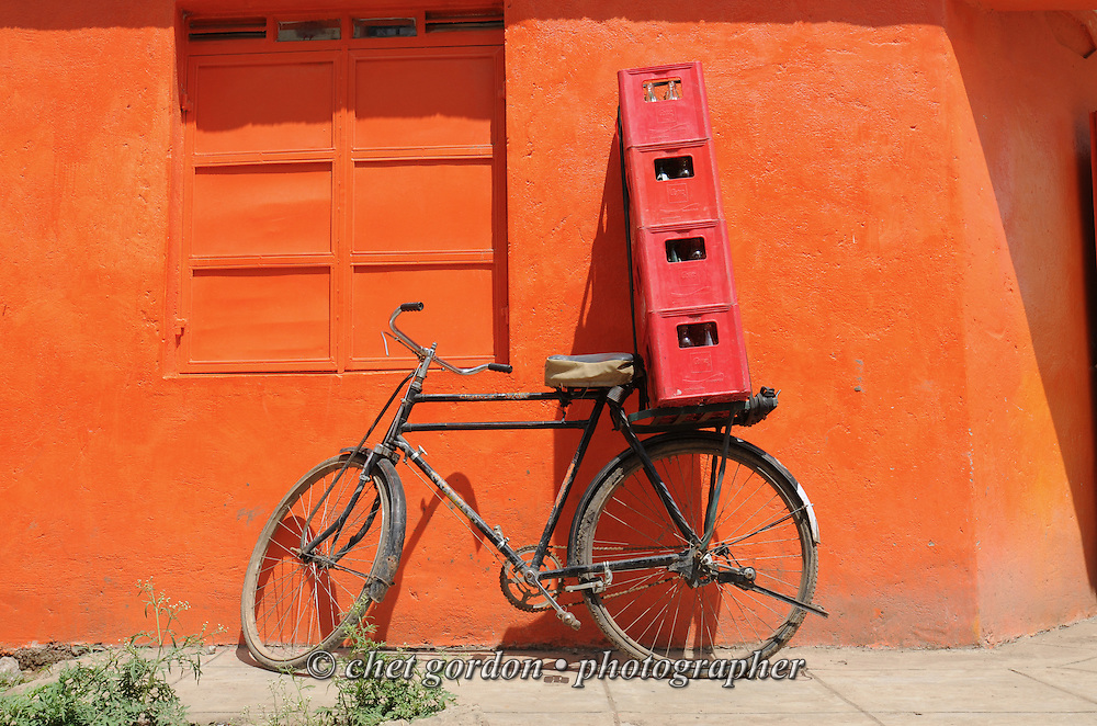 Delivery bicycle with beer cases outside a market in the Tassia neighborhood of Nairobi, Kenya on Sunday, December 4, 2011.