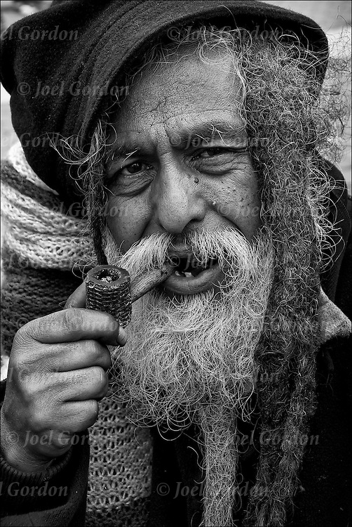 Portrait of Homeless street person in park..Without needed medication or consistent mental health care, persons with serious and persistent mental health problems may be forced to live on the streets in precarious circumstances...