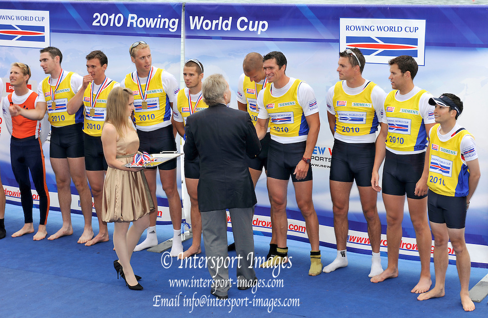 Bled, SLOVENIA,  Men's  Eights, GBR M8+ gold medalist, medal presentation, FISA President presents Greg SEARLE with his medal.  at the 1st FISA World Cup. Third day. Bow, Nataniel REILLY-O'DONNELL, James CLARKE, James ORME, James FOAD, Mohamad SBIHI, Greg SEARLE, Peter REED, Daniel RITCHIE and Cox Phelan HILL. Rowing Course. Lake Bled.  Sunday  30/05/2010  [Mandatory Credit Peter Spurrier/ Intersport Images]