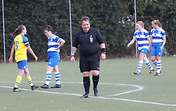 """EXCLUSIVE: **NO WEB UNTIL 6pm GMT 20th August** The world's first transgender ref made her debut at QPR's training ground in London. Taxi driver Lucy Clark, 46, took charge of hundreds of non-league games as Nick but revealed at the weekend how she felt trapped in a man's body. Lucy, who has three kids, reffed QPR's female youth team v Parkwood Ladies at the Championship side's West London training ground. QPR's Jess Painter said after her side's 4-2 win: """"The ref was great — one of the best we've ever had."""" With a pink whistle and a ponytail, the arm-tattooed official formerly known as Nick booked one woman for a scything tackle in the second half during the home side's 4-2 win. Lucy was watched by supportive wife Avril from the sidelines and Kellie Moloney, the former boxing promoter called Frank who became a woman. Dressed all in black, Lucy showed no nerves officiating during the London and South East Women's Football's Premier League opening day clash. 18 Aug 2018 Pictured: Lucy Clark. Photo credit: W8Media / MEGA TheMegaAgency.com +1 888 505 6342"""