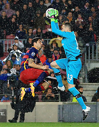 Luis Suarez of Barcelona jumps with Arsenal's David Ospina  - Mandatory byline: Matt McNulty/JMP - 16/03/2016 - FOOTBALL - Nou Camp - Barcelona,  - FC Barcelona v Arsenal - Champions League - Round of 16