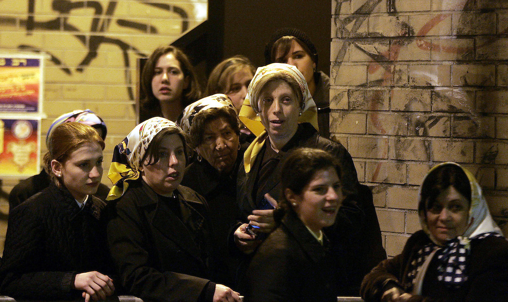 A group of ultra-Orthodox women and girls watch as the body of Grand Rabbi Moses Teitelbaum, worldwide spiritual leader of tens of thousands of members of the ultra-Orthodox Jewish sect, Satmar Hassidim, is carried into the Yetev Lev D'Satmar synagogue in Brooklyn, New York after he died in New York City at the age of 91 Monday 24 April 2006.