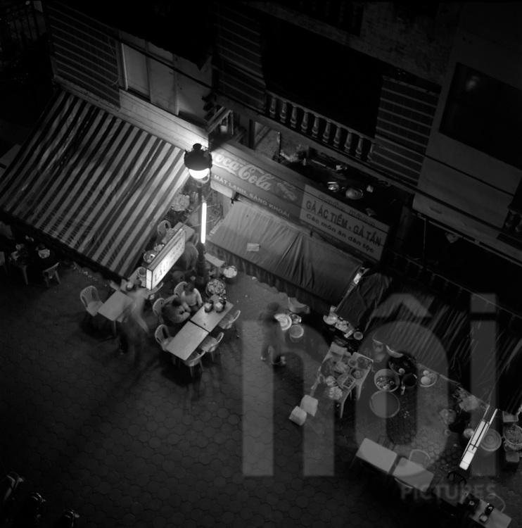 """Tong Duy Tan, """"Hunger street"""", in Hanoi, Vietnam. December 2004"""