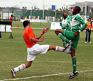 (L) SOCCER PLAYER FROM TURKMENISTAN (ORANGE) & (R) SOCCER PLAYER FROM NIGERIA (GREEN) FIGHT FOR THE BALL DURING FOOTBALL COMPETITION AT THE SPECIAL OLYMPICS WORLD SUMMER GAMES SHANGHAI 2007..SPECIAL OLYMPICS IS AN INTERNATIONAL ORGANIZATION DEDICATED TO EMPOWERING INDIVIDUALS WITH INTELLECTUAL DISABILITIES..SHANGHAI , CHINA , OCTOBER 06, 2007.( PHOTO BY ADAM NURKIEWICZ / MEDIASPORT )..