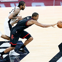 01 May 2017: Houston Rockets forward Trevor Ariza (1) brings the ball up court against San Antonio Spurs forward Kawhi Leonard (2) during the Houston Rockets 126-99 victory over the San Antonio Spurs, in game 1 of the Western Conference Semi Finals, at the AT&T Center, San Antonio, Texas, USA.