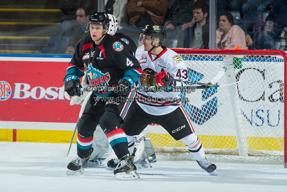KELOWNA, CANADA - OCTOBER 20:  Skyler McKenzie #43 of the Portland Winterhawks back checks Gordie Ballhorn #4 of the Kelowna Rockets during first period on October 20, 2017 at Prospera Place in Kelowna, British Columbia, Canada.  (Photo by Marissa Baecker/Shoot the Breeze)  *** Local Caption ***