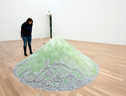 Woman looking at sculpture 1979 Liter Bis Zum (1979 litres up to the top) Anfang by Alicja Kwade