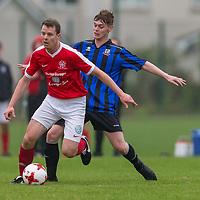 Newmarket Celtic's Kevin Hartnett gets away from Bridge United's Brandon O'Halloran