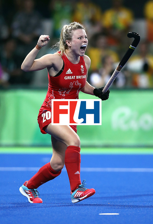 RIO DE JANEIRO, BRAZIL - AUGUST 19:  Hollie Webb of Great Britain celebrates after scoring the winning penalty against the Netherlands during the Women's Gold Medal Match on Day 14 of the Rio 2016 Olympic Games at the Olympic Hockey Centre on August 19, 2016 in Rio de Janeiro, Brazil.  (Photo by David Rogers/Getty Images)
