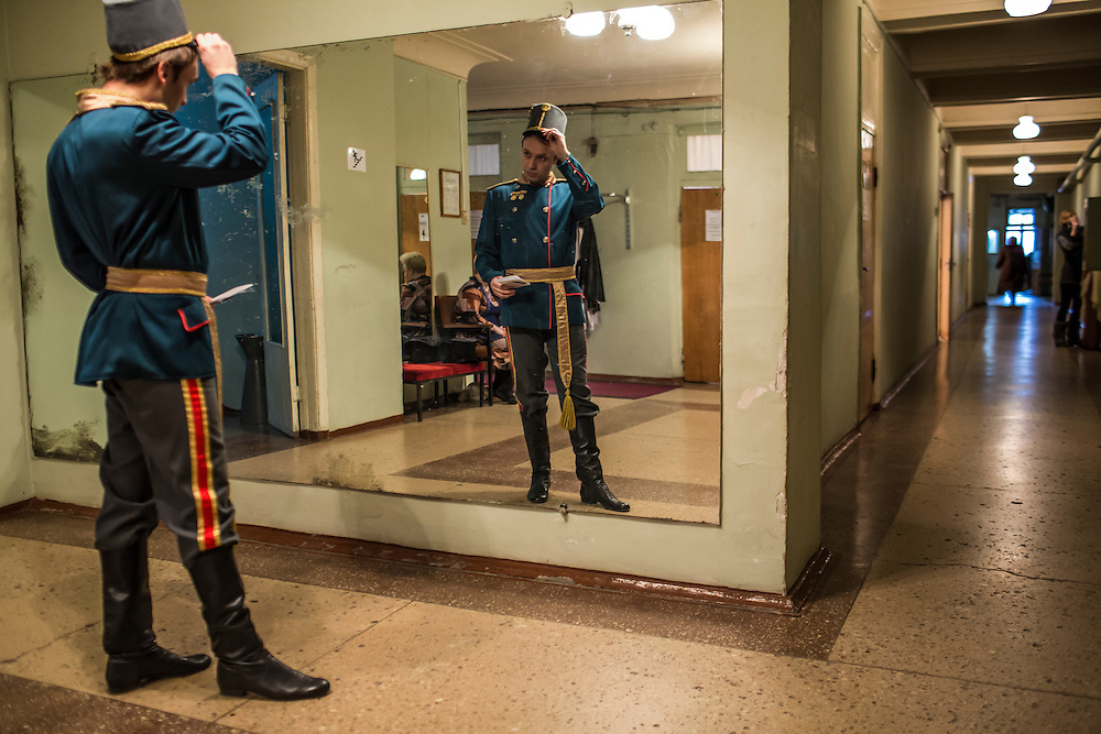 DONETSK, UKRAINE - FEBRUARY 1, 2015: Maksim Alekseychuck, a performer with the Donetsk National Academic Opera and Ballet Theatre, checks his costume back stage before a performance in Donetsk, Ukraine. The opera company kicked off a new season in October, despite a separatist insurgency in Eastern Ukraine that has killed more than 5000 people. CREDIT: Brendan Hoffman for The New York Times