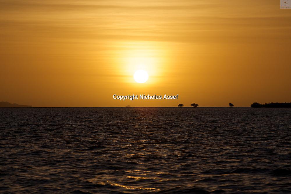 A golden sun sets after another beautiful Fijian summer's day