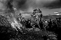 As trash burns in the dump in the late afternoon, Haitians continue to rummage through garbage of the US service men.