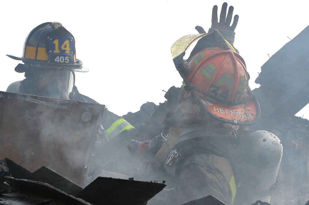 6/25/2011 Fountain Hill, PA Firefighters from across the Lehigh Valley responded at approximately 630 Saturday morning to the 603 Lachauweki Avenue in Fountain Hill Boro for house fire. Fountain Hill Fire Captain Terry Heffner has a close call when the part of the roof he was standing on collapsed sending him into the attic area. A Nancy Run Firefighter rushes to his aid however he was able to self rescue and continues fighting the fire. Express-Times Photo | CHRIS POST
