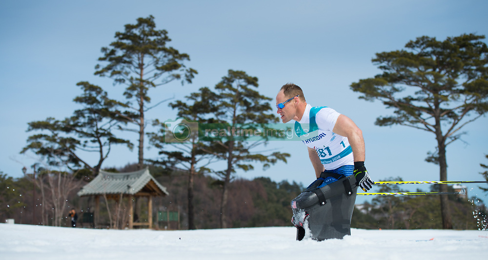 March 17, 2018 - Pyeongchang, South Korea - Dan Cnossen of the US on the final lap of his silver performance in the Cross Country 7.5km sitting event Saturday, March 17, 2018 at the Alpensia Biathlon Center at the Pyeongchang Winter Paralympic Games. Photo by Mark Reis (Credit Image: © Mark Reis via ZUMA Wire)