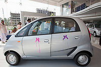 the new Tata car the Nano has been release in the shop of india and indian people seems to be really interresting by this low cost car 2000 Euros than will come soon on the western market